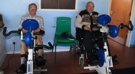 Two of our clients having fun on the exercise bikes